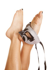 woman legs with a mask on her foot