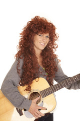 woman red hair guitar smile