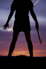 silhouette woman  legs hatchet hands out