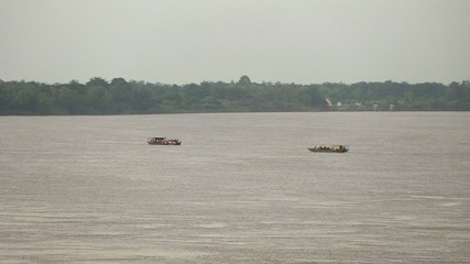Ferry boats pass each other in the mekong river