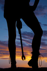 silhouette woman legs holding wrench