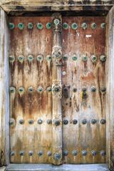 Hand crafted wooden door in Stonetown at Zanzibar