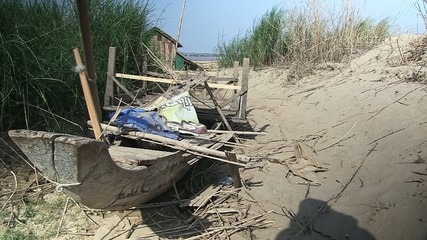 Small fishing boat abandonned near on the beach