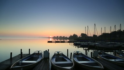 Tranquil sunrise at a marina, with bird sounds.