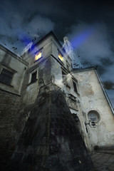Halloween night castle with ghosts