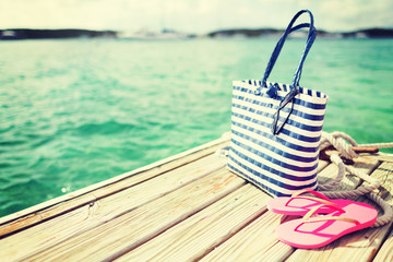 close up of beach accessories on wooden pier