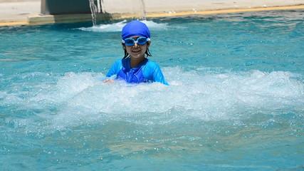 Girl swimming in pool having fun. HD