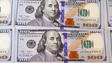 pan view over 100 dollar bills