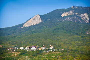 Crimean mountain landscape. Green trees, Dwelling houses