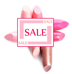 Sale concept. Several different lipsticks isolated on white