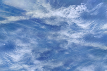 Light fluffy clouds against a clear blue sky