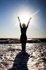Girl on the beach and sun