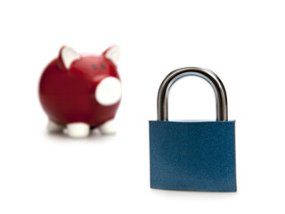 Safe saving. Piggy bank with open padlock