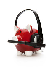 Piggy bank wearing headset