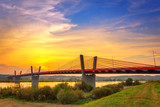 Cable stayed bridge over Vistula river in Poland at sunset. - 70225811