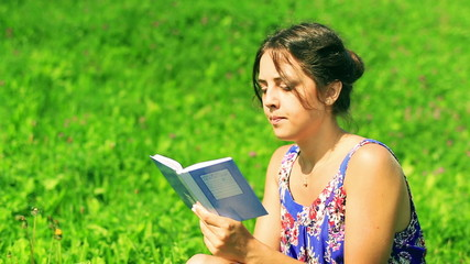 Woman sitting on the meadow and writing sad memories