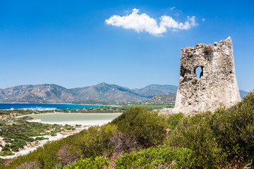 Old Tower of Porto Giunco bay.  Sardinia island. Italy.