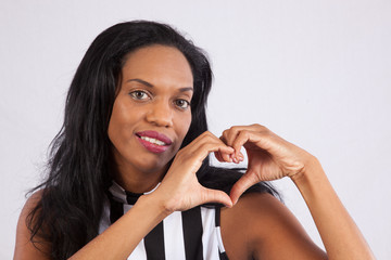 black woman making heart shape with her hands