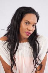 black woman looking seriously at the camera