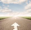 arrow on asphalt road to the horizon
