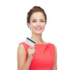 smiling woman with plastic credit card