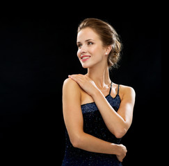 smiling woman in evening dress