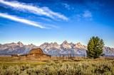 Scenic view of Grand Teton mountain range and abandoned barn - Fine Art prints