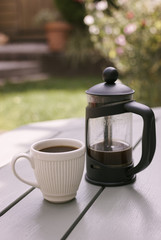French Press and White Espresso Cup