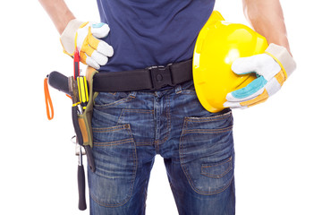 Close up of a worker with toolbelt and helmet, isolated on white