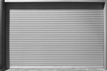 grunge metallic roller white shutter door at night