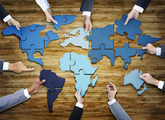 People s Hand with Jigsaw Forming in World Map