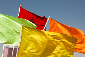 Flags of Morocco waving against blue sky