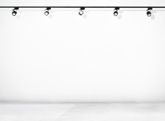 White Wall and Concrete Floor with Spotlights
