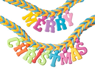 Colorful rubber band bracelet with the words MERRY CHRISTMAS