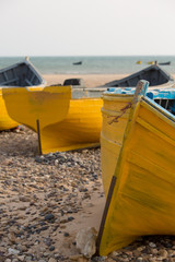 Yellow fishing boats on the beach of Sidi Kaouki