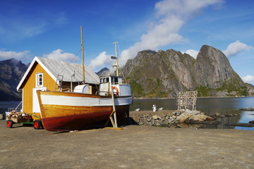 Fishing boat and house on the Lofoten Islands, Norway.