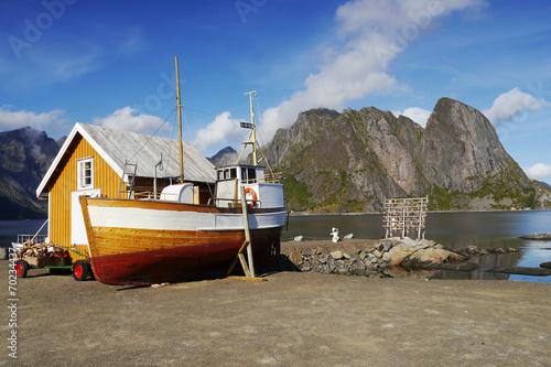 Aluminium Fishing boat and house on the Lofoten Islands, Norway.