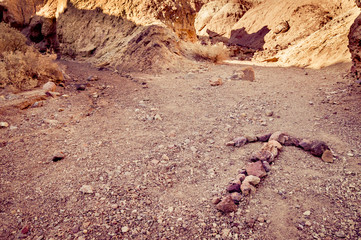 arrow made with rocks in death valley national park