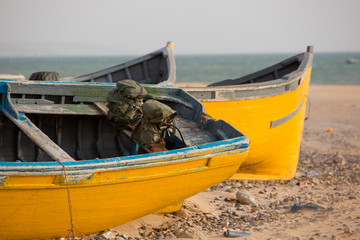 Two Colored fishing boats on the beach of Sidi Kaouki