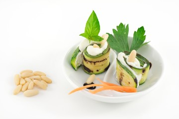 grilled zucchini rolls with cheese and pine nuts