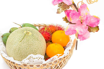 fruit in basket on white background