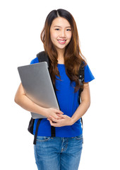 Asian woman student with backpack and laptop