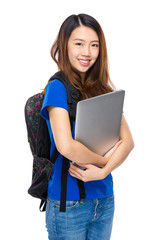 Woman student with backpack and laptop