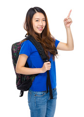 Woman student with backpack and finger up