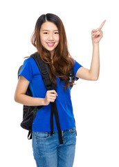 Woman student with backpack and finger point up