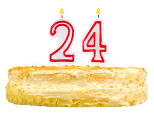 birthday cake with candles number twenty four isolated on white