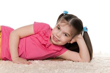 Little girl on the white carpet