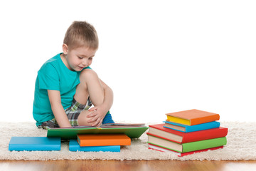 Clever little boy reads a book
