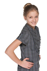 Profile portrait of a smiling preteen girl