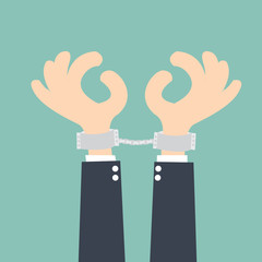 businessman handcuffed hands